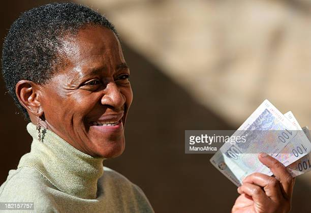 ethnic woman with notes 1 - south african currency stock photos and pictures