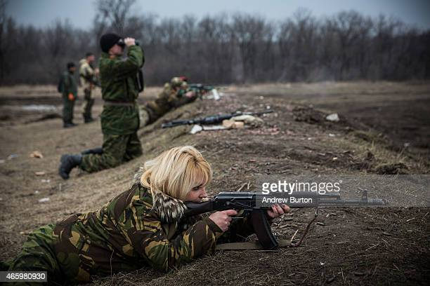 Ethnically Cossack proRussian rebels practice their firearms skills at a firing range on March 12 2015 in Donetsk Ukraine The conflict between...
