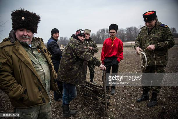 Ethnically Cossack proRussian rebels take a break after a skills performance on March 12 2015 in Makeevka Ukraine The conflict between Ukraine and...