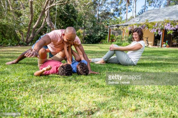 Ethnically Diverse Australian Family Playing Together at Home