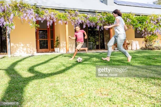 ethnically diverse australian family playing together at home - mama futbol fotografías e imágenes de stock