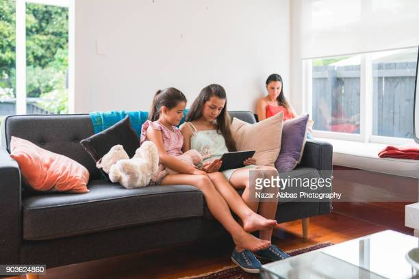 Ethnically diverse family at home relaxing.
