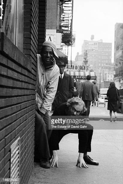 Ethnomusicologist filmmaker and painter Harry Smith poses for a portrait with musician Harmonica Slim on September 28 1965 in Greenwich Village New...