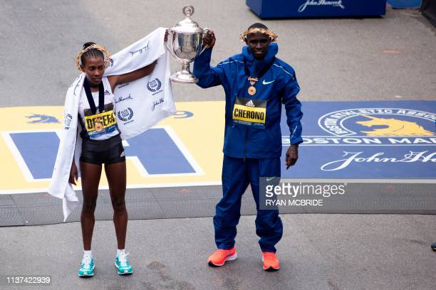 Ethopian Worknesh Degefa and Kenyan Lawrence Cherono celebrate together after they won the Women's Elite and Men's Elite races respectfully at the...