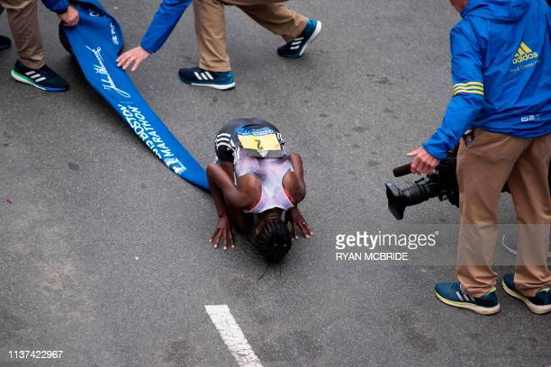 Ethopian Worknesh Degefa celebrates winning the Women's Elite race at the 123rd Boston Marathon on April 15 2019 in Boston Massachusetts Kenya's...