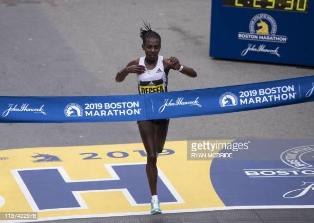 Ethopian Worknesh Degefa wins the Women's Elite race at the 123rd Boston Marathon on April 15 2019 in Boston Massachusetts Kenya's Lawrence Cherono...
