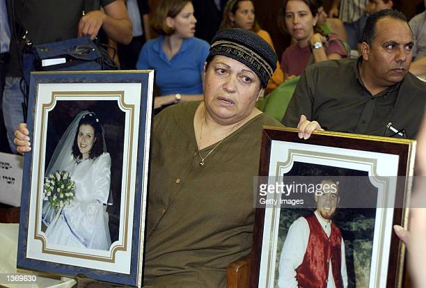 Eti BenShalom the mother of Yaniv and motherinlaw of Sharon who where killed in a Palestinian attack near Jerusalem in 2001 holds their pictures as...