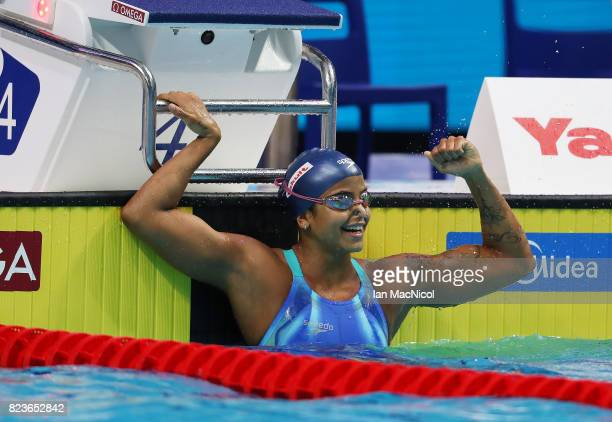 Etiene Medeiros of Brazil celebrates after she wins 50m Backstroke final on day fourteen of the FINA World Championships at the Duna Arena on July...