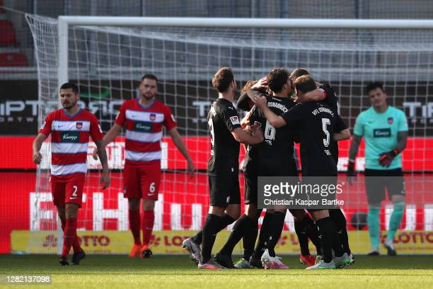 Etienne Amenyido of VfL Osnabruck celebrates with teammates after scoring his team's first goal during the Second Bundesliga match between 1. FC...