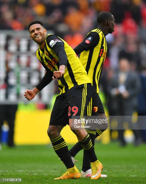 Etienne Capoue and Abdoulaye Doucoure of Watford celebrate victory after the FA Cup Semi Final match between Watford and Wolverhampton Wanderers at...