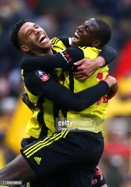Etienne Capoue and Abdoulaye Doucoure of Watford FC celebrate winning the FA Cup Semi Final match between Wolverhampton Wanders and Watford FC at...