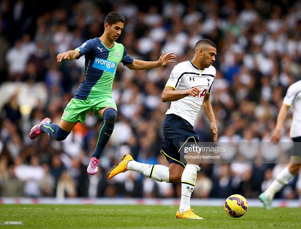 Etienne Capoue of Spurs holds off Ayoze Perez of Newcastle during the Barclays Premier League match between Tottenham Hotspur and Newcastle United at White Hart Lane on October 26, 2014 in London, England.