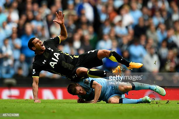 Etienne Capoue of Spurs is tackled by James Milner of Manchester City during the Barclays Premier League match between Manchester City and Tottenham...