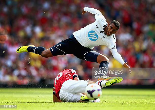Etienne Capoue of Spurs leaps over a challenge from Aaron Ramsey of Arsenal during the Barclays Premier League match between Arsenal and Tottenham...