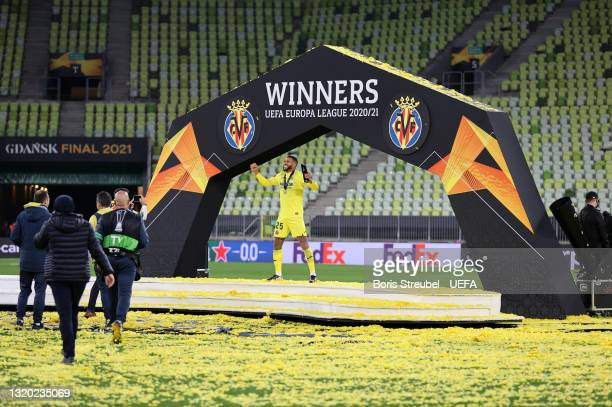 Etienne Capoue of Villarreal CF celebrates in front of the winners podium after their side's victory after the UEFA Europa League Final between...