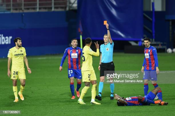 Etienne Capoue of Villarreal CF is shown a red card by Match Referee, David Medie Jimenez during the La Liga Santander match between SD Eibar and...