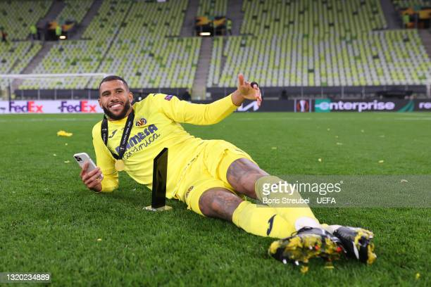 Etienne Capoue of Villarreal CF poses for a photograph as he celebrates their side's victory after the UEFA Europa League Final between Villarreal CF...