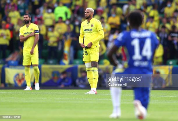 Etienne Capoue of Villarreal stands as Trevoh Chalobah of Chelsea takes a knee in support of the Black Lives Matter movement prior to the UEFA Super...