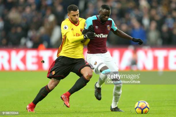 Etienne Capoue of Watford and Cheikhou Kouyate of West Ham battle for the ball during the Premier League match between West Ham United and Watford at...