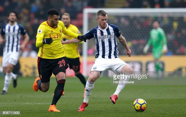 Etienne Capoue of Watford and Chris Brunt of West Bromwich Albion battle for the ball during the Premier League match between Watford and West...