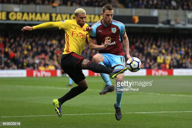 Etienne Capoue of Watford and Chris Wood of Burnley battle for the ball during the Premier League match between Watford and Burnley at Vicarage Road...
