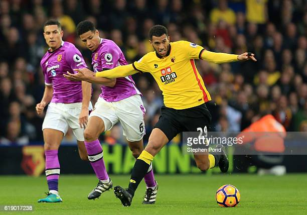Etienne Capoue of Watford and Curtis Davies of Hull City compete for the ball during the Premier League match between Watford and Hull City at...