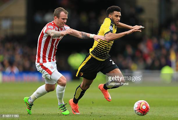 Etienne Capoue of Watford and Glenn Whelan of Stoke City compete for the ball during the Barclays Premier League match between Watford and Stoke City...