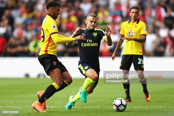 Etienne Capoue of Watford and Jack Wilshere of Arsenal both challenge for the ball during the Premier League match between Watford and Arsenal at...
