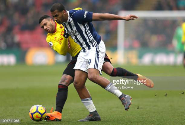 Etienne Capoue of Watford and Jose Salomon Rondon of West Bromwich Albion battle for the ball during the Premier League match between Watford and...