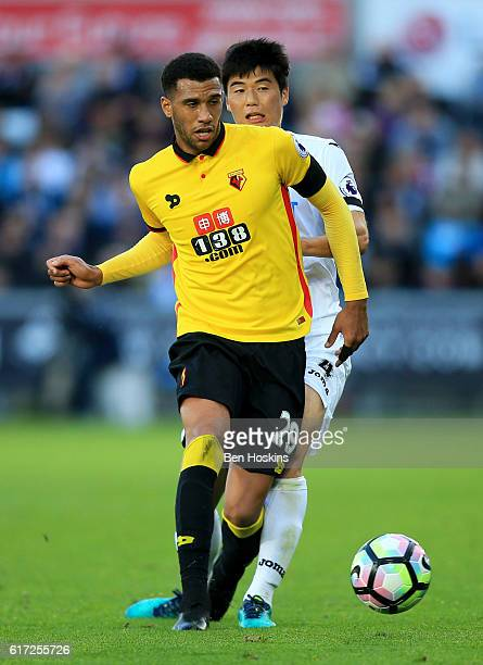 Etienne Capoue of Watford and Ki SungYueng of Swansea City compete for the ball during the Premier League match between Swansea City and Watford at...