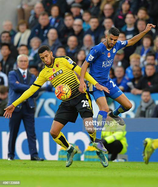 Etienne Capoue of Watford and Riyad Mahrez of Leicester City compete for the ball during the Barclays Premier League match between Leicester City and...