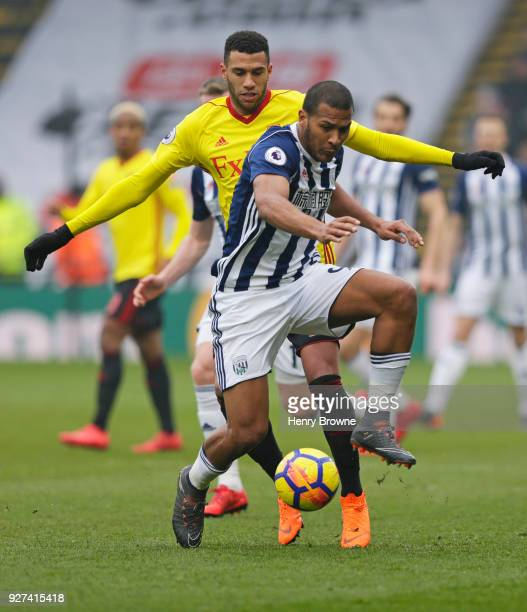 Etienne Capoue of Watford and Salomon Rondon of West Bromwich Albion during the Premier League match between Watford and West Bromwich Albion at...