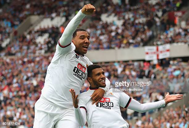 Etienne Capoue of Watford and Troy Deeney of Watford during the Premier League match between West Ham United and Watford at Olympic Stadium on...