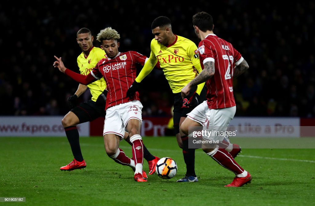 Etienne Capoue of Watford battes with Lloyd Kelly of Bristol City watched by Richarlison of Watford and Marlon Pack of Bristol City during the Emirates FA Cup Third Round match between Watford and Bristol City at Vicarage Road on January 6, 2018 in Watford, England.