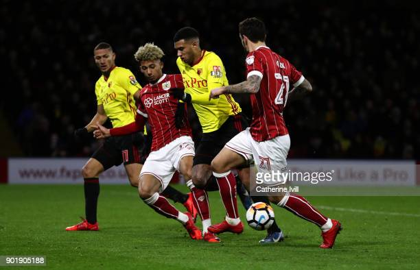 Etienne Capoue of Watford battes with Lloyd Kelly of Bristol City watched by Richarlison of Watford and Marlon Pack of Bristol City during the...