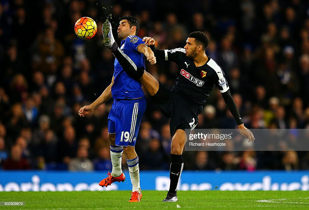 Etienne Capoue of Watford battles for the ball with Diego Costa of Chelsea during the Barclays Premier League match between Chelsea and Watford at Stamford Bridge on December 26, 2015 in London, England.