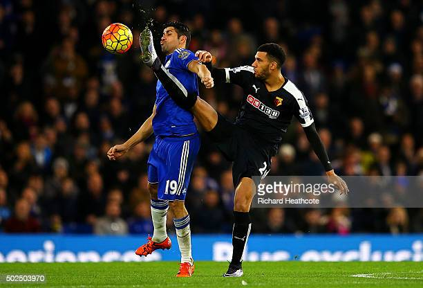 Etienne Capoue of Watford battles for the ball with Diego Costa of Chelsea during the Barclays Premier League match between Chelsea and Watford at...