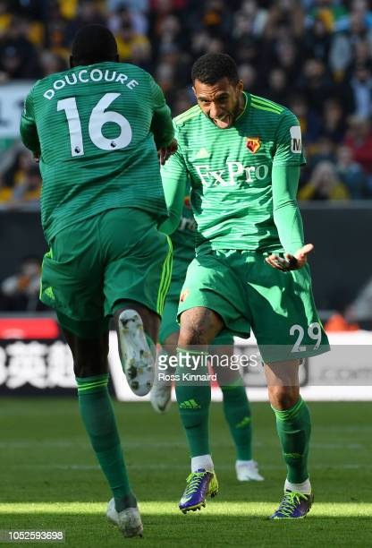 Etienne Capoue of Watford celebrates after scoring his team's first goal with Abdoulaye Doucoure of Watford during the Premier League match between...