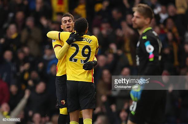 Etienne Capoue of Watford celebrates scoring his sides first goal with Roberto Pereyra of Watford during the Premier League match between Watford and...