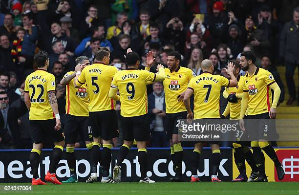Etienne Capoue of Watford celebrates scoring his sides first goalw ith his Watford team mates during the Premier League match between Watford and...