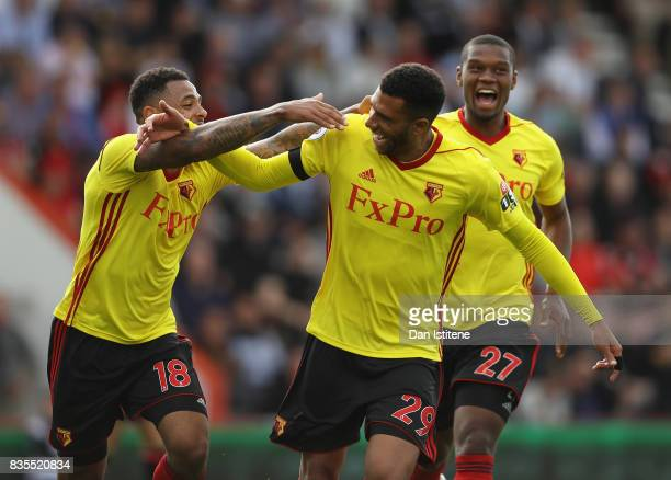 Etienne Capoue of Watford celebrates scoring his sides second goal with Andre Gray of Watford and Christian Kabasele of Watford during the Premier...
