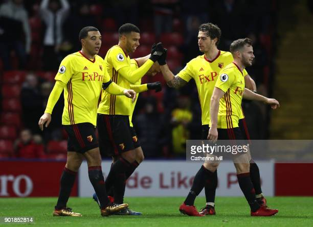 Etienne Capoue of Watford celebrates scoring the 3rd Watford goal with team mates during The Emirates FA Cup Third Round match between Watford and...