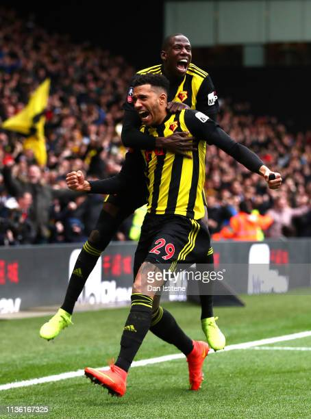 Etienne Capoue of Watford celebrates with teammate Abdoulaye Doucoure after scoring his team's first goal during the FA Cup Quarter Final match...