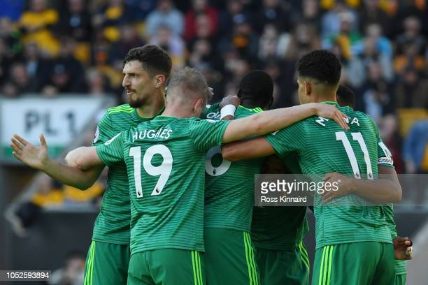 Etienne Capoue of Watford celebrates with teammates after scoring his team's first goal during the Premier League match between Wolverhampton...