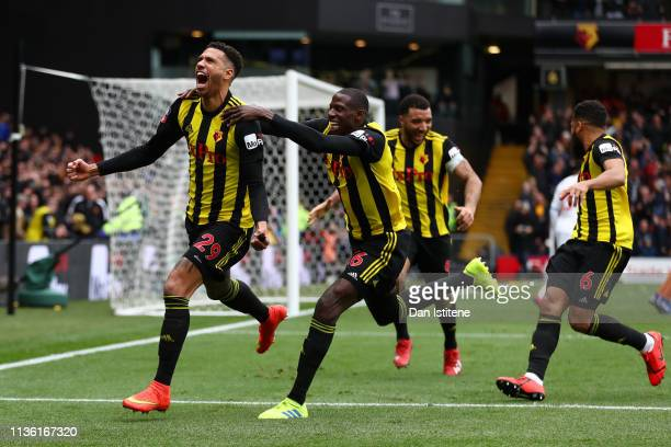 Etienne Capoue of Watford celebrates with teammates after scoring his team's first goal during the FA Cup Quarter Final match between Watford and...