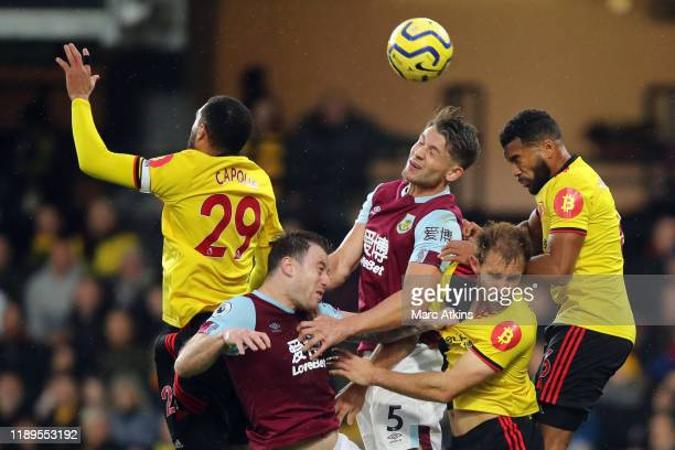 Etienne Capoue of Watford, during Ashley Barnes, James Tarkowski of Burnley, Craig Dawson and Adrian Mariappa of Watford jump for the ball during the...