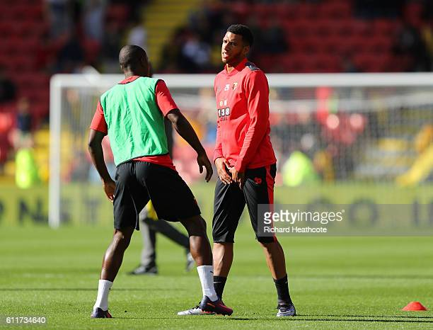 Etienne Capoue of Watford holds his groin after warming up during the Premier League match between Watford and AFC Bournemouth at Vicarage Road on...