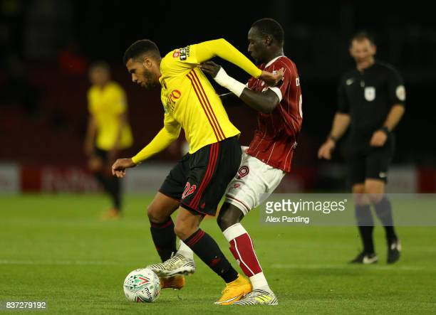 Etienne Capoue of Watford holds off Famara Diedhiou of Bristol City during the Carabao Cup Second Round match between Watford and Bristol City at...
