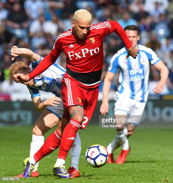 Etienne Capoue of Watford is challenged by Alex Pritchard of Huddersfield Town during the Premier League match between Huddersfield Town and Watford...