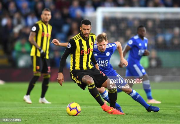 Etienne Capoue of Watford is challenged by Marc Albrighton of Leicester City during the Premier League match between Leicester City and Watford FC at...